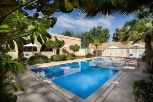 The swimming pool at or near Millennium Central Al Mafraq