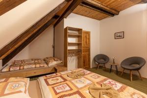 Postel nebo postele na pokoji v ubytování Chata Rychtářka