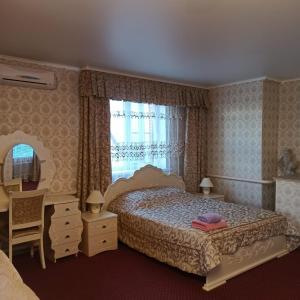 """Кровать или кровати в номере гостиница """"Постоялый Двор"""""""