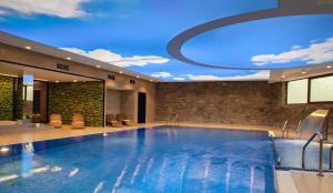 The swimming pool at or near Hotel Crocus