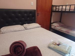 A bed or beds in a room at Hostel Aeroporto