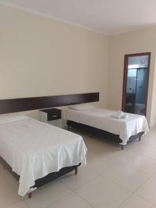A bed or beds in a room at Hotel Martins