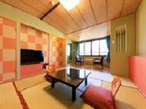 A television and/or entertainment center at Seaside Hotel Mimatsu Ooetei