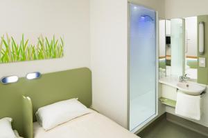 A bathroom at ibis budget Hotel Edinburgh Park