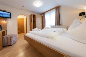 Postel nebo postele na pokoji v ubytování Hotel Schröckerhof