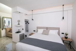 Ένα ή περισσότερα κρεβάτια σε δωμάτιο στο Kallos Imar Hotel