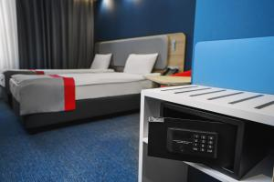 A bed or beds in a room at Holiday Inn Express Moscow - Khimki Go Park, an IHG Hotel