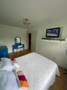 A bed or beds in a room at Hospital de Clínicas e Parque da Redenção