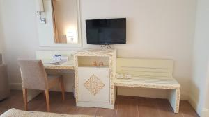 A television and/or entertainment center at Crystal Admiral Resort Suites & Spa