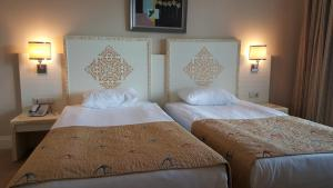 A bed or beds in a room at Crystal Admiral Resort Suites & Spa