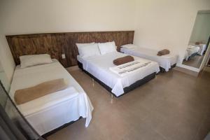 Cama ou camas em um quarto em Pousada Canyons