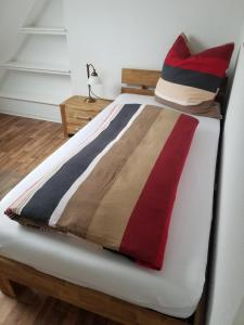 A bed or beds in a room at Apartment Rheinwiesen Flair & Fair