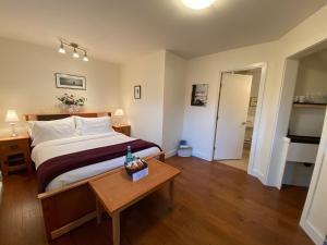 A bed or beds in a room at Liahona Guest House