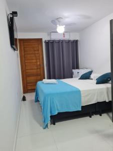 A bed or beds in a room at Suites Golfo
