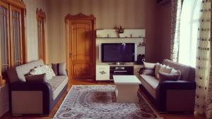 Uma área de estar em Paradise Villa