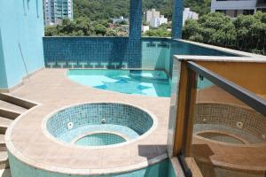 Вид на бассейн в Horto Executivo Hotel или окрестностях