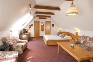 Ein Sitzbereich in der Unterkunft Hotel Biedermeier Hof