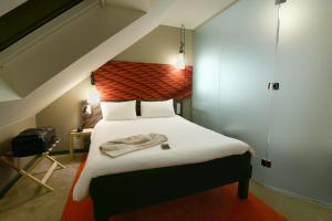 Un ou plusieurs lits dans un hébergement de l'établissement ibis Brest Kergaradec
