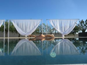 The swimming pool at or near VILAPURA - Naturism