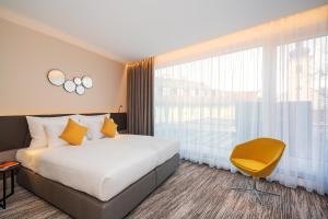 Łóżko lub łóżka w pokoju w obiekcie Hotel CUBE Prague