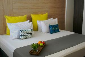 A bed or beds in a room at Hotel CasaBlanca Cucuta