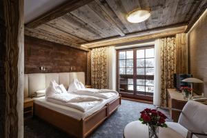 Łóżko lub łóżka w pokoju w obiekcie Alpejski Boutique Hotel