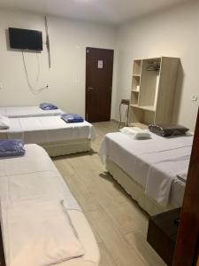 Cama ou camas em um quarto em Hotel Paradizzo