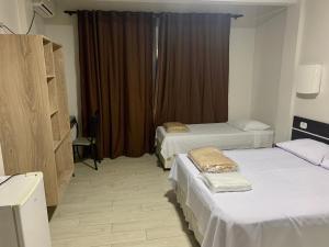 Cama o camas de una habitación en Hotel Paradizzo