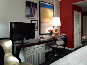 A television and/or entertainment center at Kimpton Hotel Monaco Seattle, an IHG Hotel