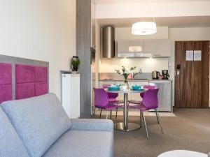 A kitchen or kitchenette at VacationClub - Baltic Park Molo Apartment D307