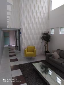 A seating area at Studio Iracema - APTO 1502