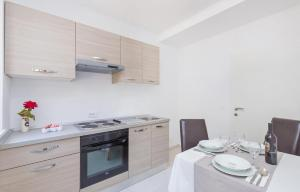 A kitchen or kitchenette at Accommodation Duper