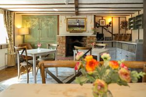 A restaurant or other place to eat at Woodleys Farmhouse