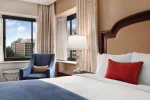 A bed or beds in a room at Capital Hilton