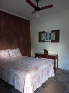 A bed or beds in a room at Recanto Pousada Sonho Meu