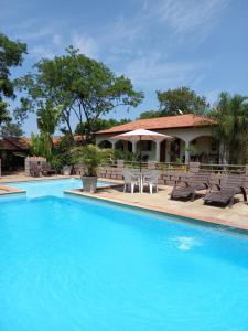 The swimming pool at or near Recanto Pousada Sonho Meu