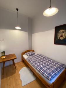 Posteľ alebo postele v izbe v ubytovaní Tichý apartmán blízko centra