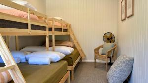 A bunk bed or bunk beds in a room at BIG4 Wye River Holiday Park