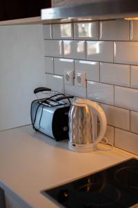 A kitchen or kitchenette at Villa Fantasia