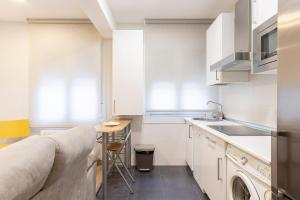 A kitchen or kitchenette at CITY HALL V apartment by Aston Rentals