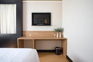 Cama ou camas em um quarto em Cambirela Hotel