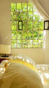 Una cama o camas en una habitación de CASITA BOUTIQUE