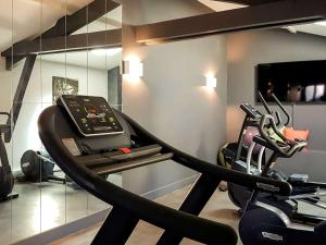 The fitness center and/or fitness facilities at La Cour des Consuls Hotel and Spa Toulouse - MGallery