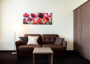 Ein Sitzbereich in der Unterkunft Hotel Germania