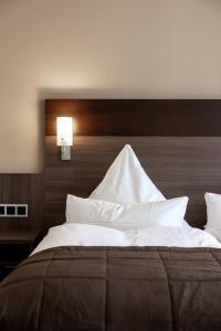 Ein Bett oder Betten in einem Zimmer der Unterkunft Hotel Germania