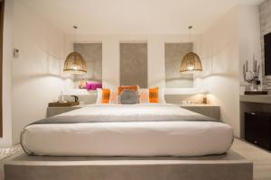 A bed or beds in a room at True Home Hotel