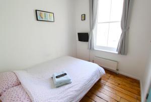 Cama o camas de una habitación en Seadragon Backpackers