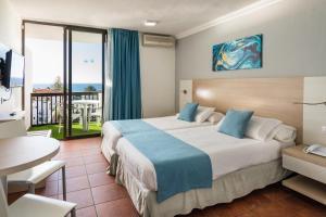 Een bed of bedden in een kamer bij Hotel New Folías