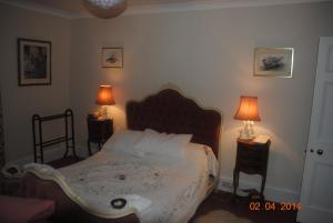A bed or beds in a room at Elmfield