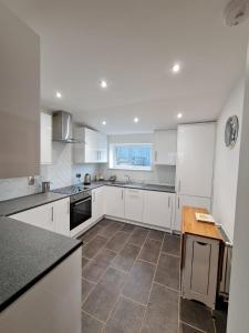 A kitchen or kitchenette at Bruxie Holiday Cottages